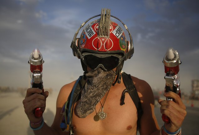 "Dillon Bracken attends the Burning Man 2014 ""Caravansary"" arts and music festival in the Black Rock Desert of Nevada, August 30, 2014. (Photo by Jim Urquhart/Reuters)"