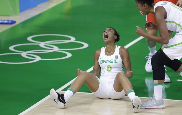 Brazil guard Joice Rodrigues reacts after scoring and drawing a foul during the first half of a women's basketball game against Belarus at the Youth Center at the 2016 Summer Olympics in Rio de Janeiro, Brazil, Tuesday, August 9, 2016. (Photo by Carlos Osorio/AP Photo)