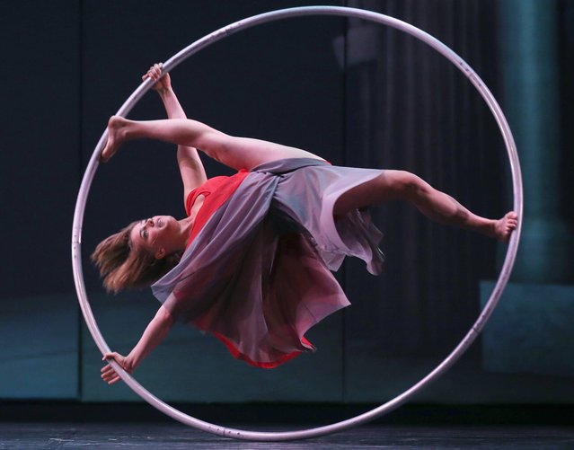 Lea Toran Jenner of the Canadian troupe Cirkopolis performs with a ring during a dress rehearsal at the Sydney Opera House in Sydney, Australia Thursday, October 2, 2014. The show combines circus, dance and theatre, featuring twelve acrobats and artists is playing at the Opera House from Oct. 2 to Oct. 6. (Photo by Rick Rycroft/AP Photo)