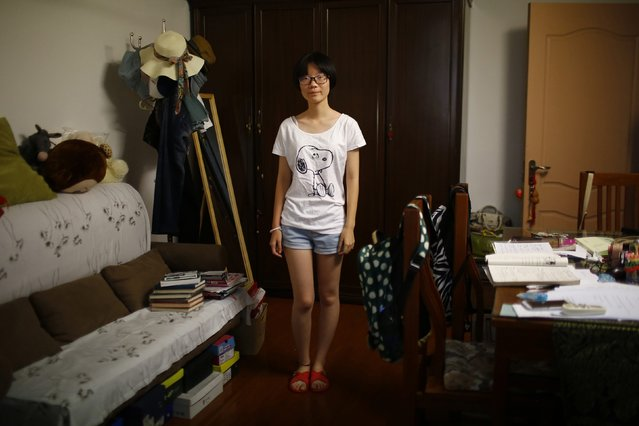 "Zhang Xiaoying, who was born in 1998, poses for a photograph in Shanghai August 24, 2014. Xiaoying said, ""Yes, because if I had a brother older than me, he could help me do many things, play with me"". (Photo by Carlos Barria/Reuters)"