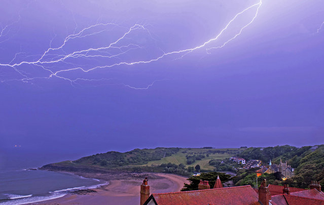 Fork lightening rains down over Langland Bay near Swansea, Wales in the early hours of this morning on May 21, 2020. (Photo by Phil Rees/Rex Features/Shutterstock)