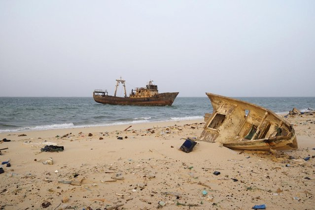 A decaying boat is seen docked off the port of Nouadhibou June 25, 2014. (Photo by Joe Penney/Reuters)