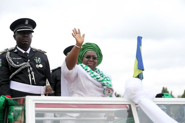 Lagos' deputy governor, Idiat Adebule, waves as she is driven during a parade to commemorate Nigeria's 55th Independence Dayin Lagos, October 1, 2015.  REUTERS/Akintunde Akinleye