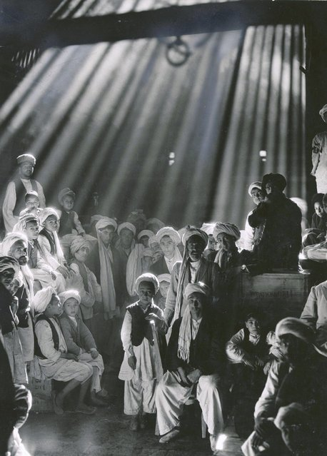 Afghanistan, 1931. In his favorite picture, legendary National Geographic photojournalist Maynard Owen Williams marveled how, in this Herat, Afghanistan, bazaar, no one blinked during the three seconds required to make the exposure. (Photo by Maynard Owen Williams