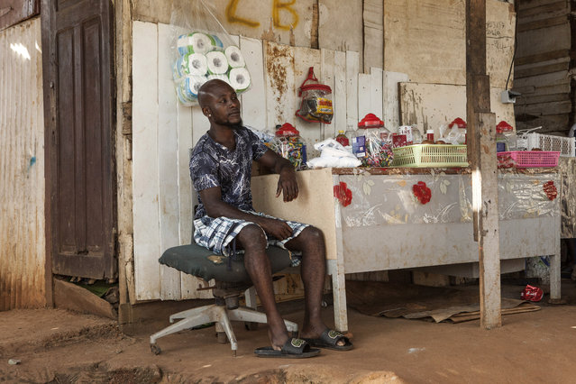 A man waits for customers in his shop in the slum district of Mont Baduel, in Cayenne, French Guiana, Friday, July 10, 2020. France's most worrisome virus hotspot is in fact on the border with Brazil - in French Guiana, a former colony where health care is scarce and poverty is rampant. The pandemic is exposing deep economic and racial inequality in French Guiana that residents say the mainland has long chosen to ignore. (Photo by Pierre Olivier Jay/AP Photo)