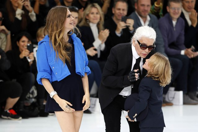 German designer Karl Lagerfeld (C) appear with models Cara Delevingne (L) and Hudson Kroenig at the end of his Spring/Summer 2016 women's ready-to-wear collection for fashion house Chanel at the Grand Palais which is transformed into a Chanel airport during the Fashion Week in Paris, France, October 6, 2015. (Photo by Charles Platiau/Reuters)