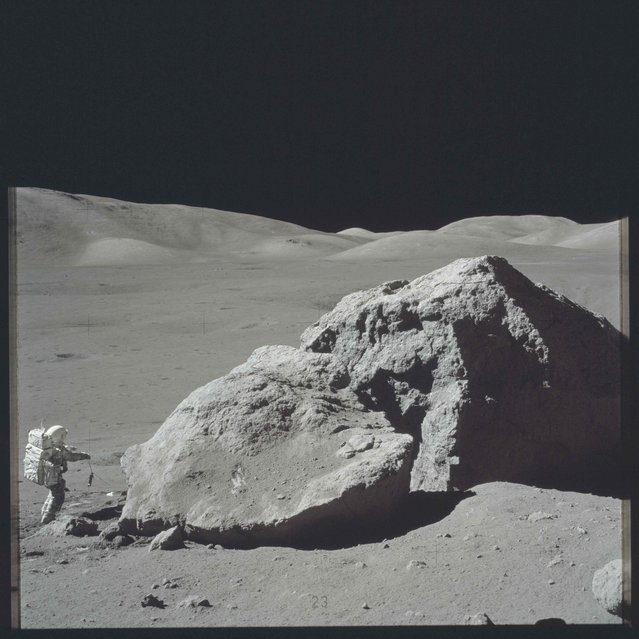 Scientist-astronaut Harrison H. Schmitt is photographed standing next to a huge, split boulder during the third Apollo 17 extravehicular activity (EVA) at the Taurus-Littrow landing site on the moon during the Apollo 17 mission in this December 13, 1972 NASA handout photo. (Photo by Reuters/NASA)