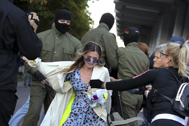 Protesters try to prevent police from detaining a demonstrator, center, during a rally in support of Maria Kolesnikova, and other members of the Coordination Council created by the opposition to facilitate talks with Lukashenko on a transition of power, was detained Monday in the capital of Minsk with two other council members, in Minsk, Belarus, Wednesday, September 9, 2020. The leading opposition candidate in Belarus' disputed presidential election said Wednesday that the political tension in her country should be solved internally, by the Belarusian people, but she did not exclude the need for future international mediation. (Photo by AP Photo/Stringer)
