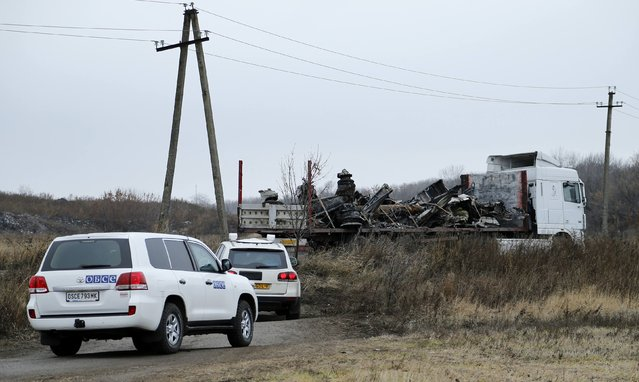 A truck transports wreckage of the Malaysia Airlines Boeing 777 plane (flight MH17) at the site of the plane crash near the settlement of Grabovo in the Donetsk region November 16, 2014. (Photo by Antonio Bronic/Reuters)
