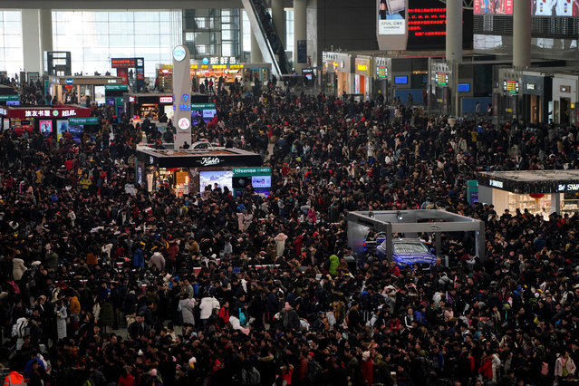 Passengers wait to board trains at Shanghai's Hongqiao Railway Station as the annual Spring Festival travel rush begins ahead of the Chinese Lunar New Year in Shanghai, China on February 1, 2018. (Photo by Aly Song/Reuters)
