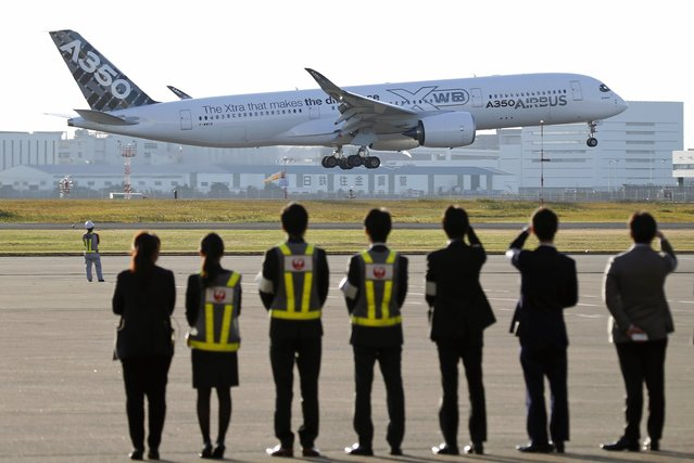 An Airbus A350 XWB aircraft lands for its market survey as Japan Airlines' (JAL) officials look on at Haneda airport in Tokyo November 19, 2014. JAL placed a major order with Airbus for 31 A350 XWBs, which are scheduled for delivery to JAL from 2019, according to an Airbus press release. (Photo by Toru Hanai/Reuters)