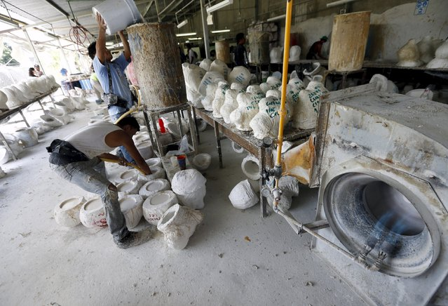 An employee works on moulds of Guzman masks at Grupo Rev in the Mexican city of Cuernavaca near Mexico City October 14, 2015. (Photo by Henry Romero/Reuters)