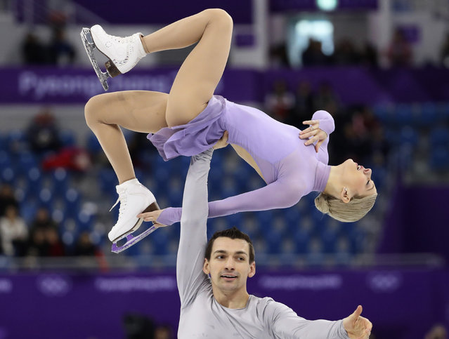 USA' s Alexa Scimeca Knierim and USA' s Chris Knierim compete in the pair skating free skating of the figure skating event during the Pyeongchang 2018 Winter Olympic Games at the Gangneung Ice Arena in Gangneung on February 15, 2018. (Photo by Lucy Nicholson/Reuters)