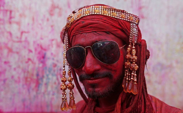 A Hindu devotee takes part in the religious festival of Holi inside a temple in Nandgaon village, in the state of Uttar Pradesh, India February 25, 2018. (Photo by Adnan Abidi/Reuters)