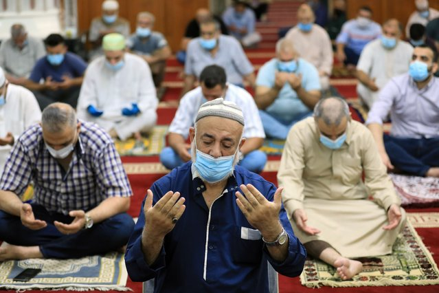 Muslims pray during the first Friday Prayer at Abu Hanifa Mosque after seven months of coronavirus (COVID-19) break in Baghdad, Iraq on October 09, 2020. (Photo by Murtadha Al-Sudani/Anadolu Agency via Getty Images)