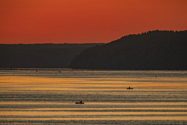 A sunrise over the Volga River in Ivanovo Region, Russia on September 4, 2020. (Photo by Vladimir Smirnov/TASS)
