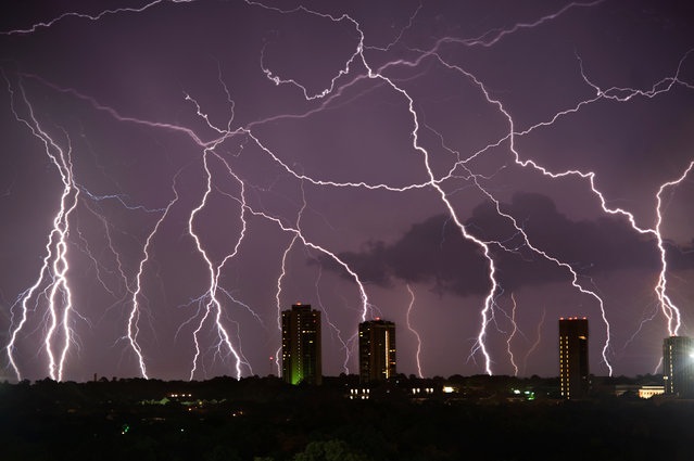 Thunder and lightning strike over Denton, Texas, June 2012. (Photo by Mike Mezeul II/Caters News)