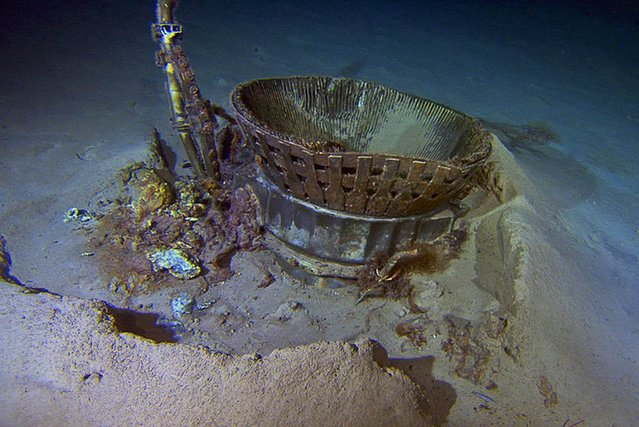 A photograph released by Bezos Expeditions on March 21 shows a thrust chamber from a Saturn 5 rocket's F-1 engine, sitting on the Atlantic Ocean bottom. Remotely operated vehicles recovered the engine components from a depth of 14,000 feet, decades after they plunged into the sea during the Apollo moon missions. The preserved engines eventually will go on display in museums in Washington, D.C., and Seattle. (Photo by Bezos Expeditions via EPA)