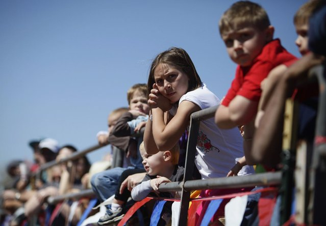 Spectators prepare to watch the ostrich race during the annual Ostrich Festival in Chandler, Arizona March 10, 2013. (Photo by Joshua Lott/Reuters)