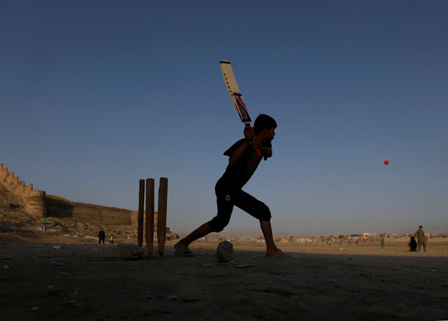 Afghan boys play cricket on a playground in Kabul, Afghanistan September 20, 2016. (Photo by Mohammad Ismail/Reuters)