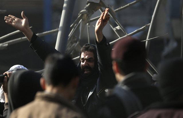A man reacts at a site hit by what activists said was an air strike by forces of Syria's President Bashar al-Assad in the Duma neighbourhood of Damascus December 27, 2014. (Photo by Bassam Khabieh/Reuters)