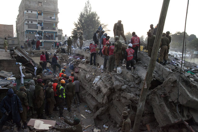 Rescue workers look for more survival on the site of the collapsed building in the capital Nairobi, Kenya, Monday, January 5, 2015. (Photo by Sayyid Azim/AP Photo)