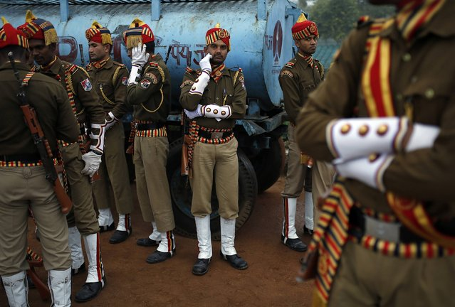 Indian soldiers take a break during their rehearsal for the Republic Day parade on a cold winter morning in New Delhi January 6, 2015. (Photo by Ahmad Masood/Reuters)