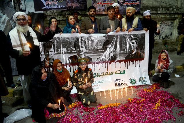 Pakistani parliamentarian Mussarat Jamshed cheema, Dr. Badar Munir and civil society workers lighting the candles during Candles Light Vigil ceremony in the remembrance of the Martyrs of Army Public School Peshawar attack, organized by Sustainable Social Development Organization (SSDO) at Press Club in Provincial Capital Lahore. Six gunmen affiliated with the Tehrik-i-Taliban Pakistan (TTP) conducted a terrorist attack on the Army Public School in the northwestern Pakistani city of Peshawar. The militants, all of whom were foreign nationals, comprising one Chechen, three Arabs and two Afghans,entered the school and opened fire on school staff and children,killing 149 people including 132 schoolchildren, ranging between eight and eighteen years of age making it the world's fourth deadliest school massacre. (Photo by Rana Sajid Hussain/Pacific Press/Rex Features/Shutterstock)