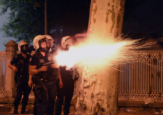 In this photo taken late Saturday, June 1, 2013, riot police fire, as they clash with protestors, near the former Ottoman palace, Dolmabahce, where Turkey's Prime Minister Recep Tayyip Erdogan maintains an office in Istanbul, Turkey. (Photo by AP Photo)