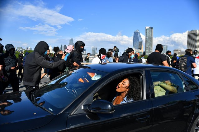 Protesters walk past a car on the Waterloo Bridge during a Black Lives Matter protest following the death of George Floyd in Minneapolis police custody, in London, Britain, June 13, 2020. (Photo by Dylan Martinez/Reuters)
