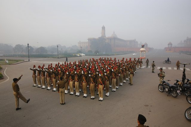 Indian Border Security Force soldiers march during rehearsals for the upcoming Republic Day parade in New Delhi, India, Thursday, January 14, 2015. (Photo by Manish Swarup/AP Photo)