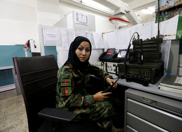 First Lieutenant in the Afghan National Army (ANA), Zainab Baqiri Shayan, 24, poses for a picture at her radio operating desk in the Ministry of Defence in Kabul, Afghanistan, October 31, 2016. (Photo by Mohammad Ismail/Reuters)