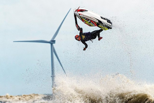 A jet skiier rides the white water off Blyth Beach, Northumberland in North East England on October 8, 2020. (Photo by Terry Cavner/South West News Service)