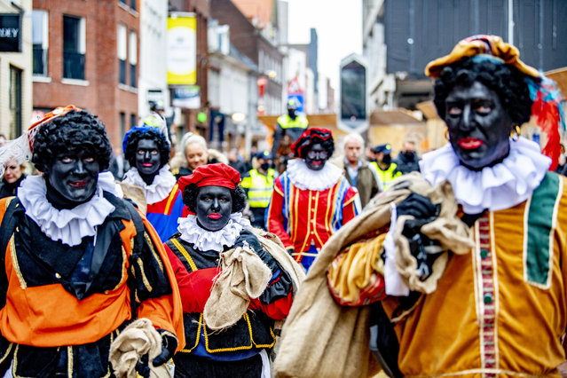 Supporters of the anti-Islam movement Pegida, dressed as the traditional Zwarte Piet, demonstrate for the preservation of Zwarte Piet. Initially, Kick Out Zwarte Piet (KOZP) would also come to Eindhoven, The Netherlands on November 22, 2020. But the action group announced on Saturday that it would cancel the demonstration due to the arrival of Pegida. In Eindhoven, there is a lot of police on Sunday for the demonstration of the extreme right-wing group Pegida, which is demonstrating for the preservation of Zwarte Piet. There are many police vans and there are also officers on horseback. The Pegida activists on the Town Hall Square are often dressed as traditional Zwarte Piet and hand out gingerbread cookies to passers-by. (Photo by Robin Utrecht/Rex Features/Shutterstock)