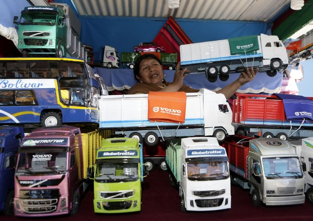 "Miniature models of trucks are displayed during the ""Alasitas"" fair in La Paz January 24, 2015. (Photo by David Mercado/Reuters)"
