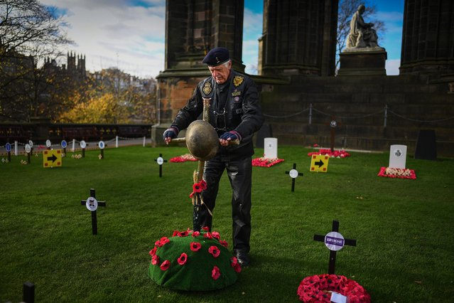 Signals veteran Jim Henderson pays tribute to those who died during war as they visit the garden of remembrance in Princess Street Gardens on November 4, 2020 in Edinburgh, Scotland. With traditional remembrance services and parades cancelled this year due to the coronavirus pandemic, people are being asked to hold the two-minute silence safely in their homes. (Photo by Jeff J. Mitchell/Getty Images)