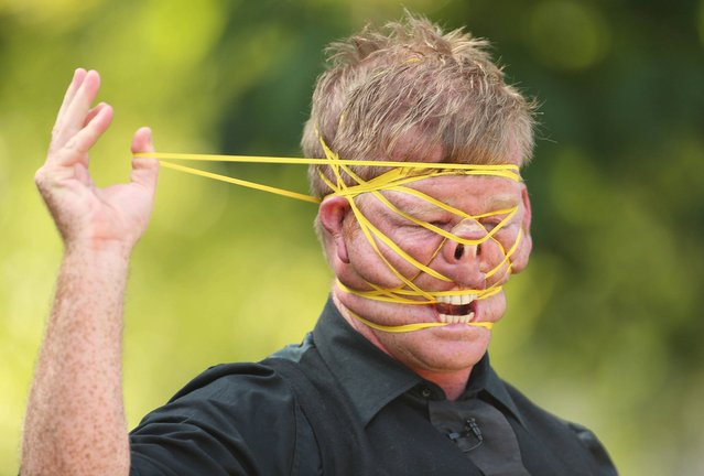 New Zealand performer Shay Horay known as the Rubberband Boy takes part in the Street Performance World Championships in Merrion Square, Dublin, on July 12, 2013. (Photo by Niall Carson/PA Wire)