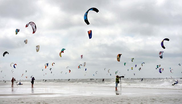Participants practice at the Kitesurfing World Cup 2013 in St. Peter-Ording, at the North Sea, Germany, on July 19, 2013. (Photo by Marcus Brandt/Dpa)