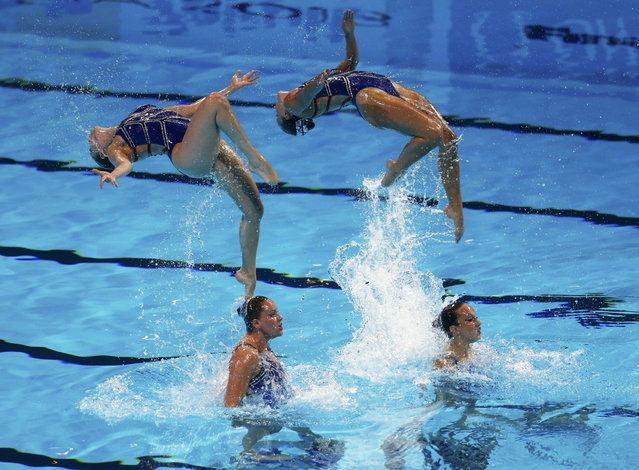 Netherland's team perform in the synchronised swimming team technical final during the World Swimming Championships at the Sant Jordi arena in Barcelona July 22, 2013. (Photo by Michael Dalder/Reuters)