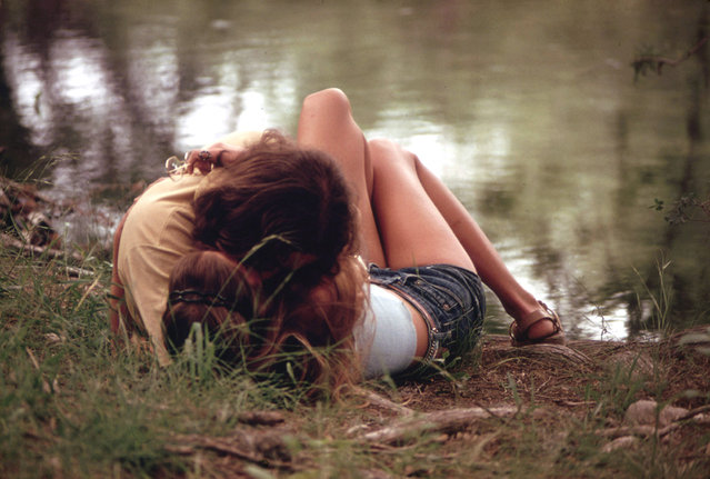 A teenage couple embraces on the bank of the Frio Canyon River near Leakey, May 1973. (Photo by Marc St. Gil/NARA via The Atlantic)