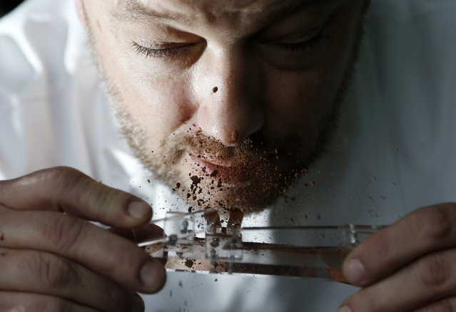 Belgian chocolatier Dominique Persoone snorts cocoa powder off his Chocolate Shooter in his factory in Bruges, February 3, 2015. (Photo by Francois Lenoir/Reuters)
