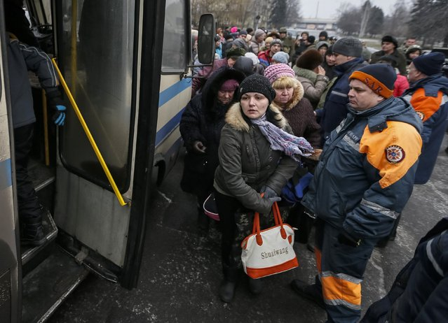 Local residents get into a bus, to flee the military conflict, in Debaltseve, eastern Ukraine, February 6, 2015. (Photo by Gleb Garanich/Reuters)