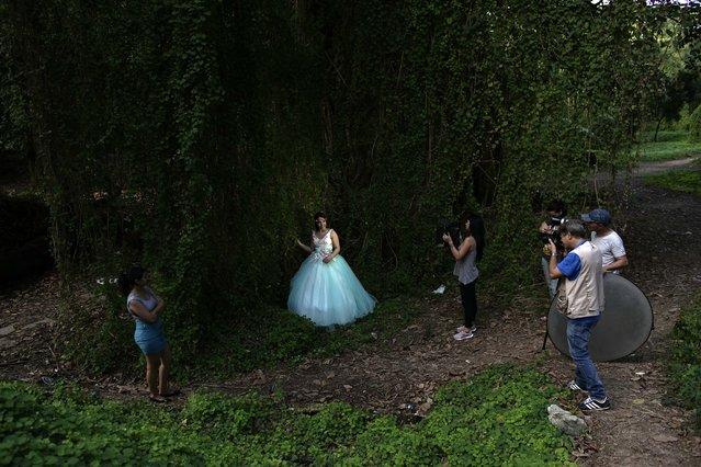 In this December 27, 2015 photo, Estefania Hernandez Perera, 14, who lives in Cuba, is photographed by FotoEcos, a studio that specializes in quinceaneras in Havana, Cuba. Many studios are run by former state sector professionals who purchased cameras with the help of U.S. relatives and have found taking pictures far more profitable than the average monthly government salary of $20. (Photo by Ramon Espinosa/AP Photo)