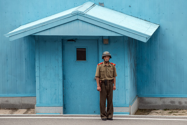A North Korean soldier stands guard on the North Korean side of the Joint Security Area in the demilitarised Zone (DMZ) on August 24, 2018 in Kaesong, North Korea. Despite ongoing international negotiations aimed at easing tensions on the Korean peninsula, the Democratic People's Republic of Korea remains the most isolated and secretive nation on earth. Since it's formation in 1948 the country has been led by the Kim dynasty, a three-generation lineage of North Korean leadership descended from the country's first leader, Kim Il-sung followed by Kim Jong-il and grandson and current leader, Kim Jong-un. Although major hostilities ceased with the signing of the Armistice in 1953, the two Koreas have remained technically at war and the demilitarised zone along the border continues to be the most fortified border in the world. (Photo by Carl Court/Getty Images)