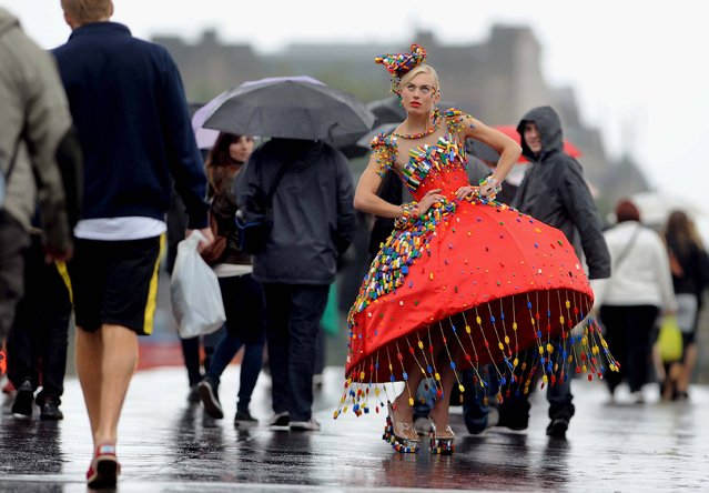 To get in to the spirit of London Fashion Week, model Aspen Glen-Cross poses in a dress adorned with around 5000 LEGO bricks designed by Central Saint Martins College of Art and Design student, Anne-Sophie Cochevelou, in central London, September 12, 2013. (Photo by Anthony Devlin/PA Wire)