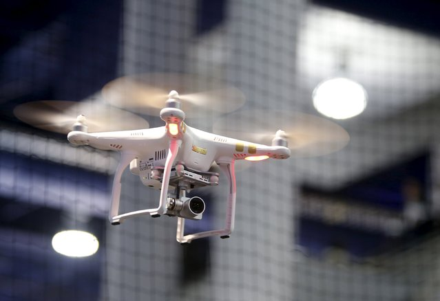 A DJI Phantom 3 Professional drone with 4K video flies in a drone cage during the 2016 CES trade show in Las Vegas, Nevada January 8, 2016. (Photo by Steve Marcus/Reuters)