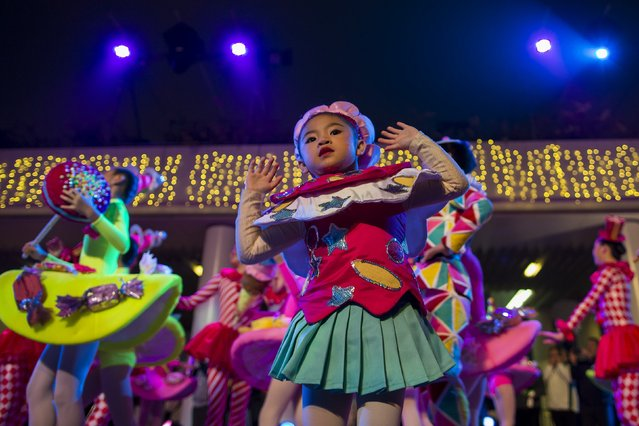 A child performer takes part in a Chinese New Year evening parade at Hong Kong's Tsim Sha Tsui shopping district February 19, 2015. (Photo by Tyrone Siu/Reuters)