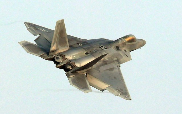 """A US Air Force F-22 Raptor stealth jet flies over a South Korean air base in Gwangju on December 4, 2017 The US and South Korea on December 4 kicked off their largest ever joint air exercise, an operation North Korea has labelled an """"all- out provocation"""", days after Pyongyang fired its most powerful intercontinental ballistic missile. (Photo by AFP Photo/Yonhap)"""