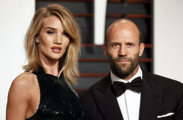 Actor Jason Stratham and model Rosie Huntington-Whiteley arrive at the 2015 Vanity Fair Oscar Party in Beverly Hills, California February 22, 2015. (Photo by Danny Moloshok/Reuters)