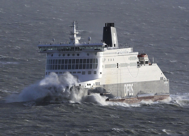 The DFDS Dover Seaways passenger ferry is engulfed by waves in heavy weather as she approaches the Port of Dover, southern England, Wednesday January 3, 2018.  A severe storm packing winds of up to 100 miles per hour has battered much of Europe overnight and Wednesday morning, bringing heavy rain, hail and lightning to the region and leaving some thousands of homes without power. (Photo by Gareth Fuller/PA Wire via AP Photo)